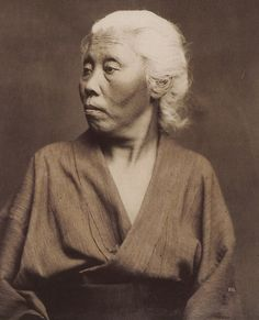 Portrait of an elderly woman in kimono. Hand-colored photo, 1870's, Japan. Photographer Felice Beato. The vast majority of 19th century Japanese portraits were of younger women, so this example is a rarity.