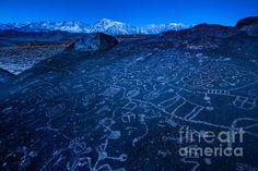 Sunrise On Sky Rock Petroglyph And Sierra Nevada Mountains, by artist Gary Whitton, available on FineArtAmerica.com