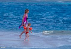 Diana, Princess of Wales, with Prince Harry on holiday on Necker Island , on January 9, 1989 in Necker Island, British Virgin Islands.