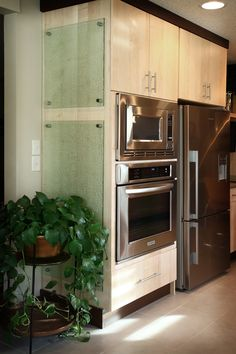 """Cast glass """"Fizee"""" cabinet side panels on brushed stainless standoffs"""