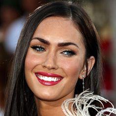 Megan Fox sporting red lips, tanned skin and crisp black liner.
