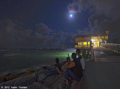 "Enjoying the ""almost"" full moon at 61st Street Fishing Pier.#galvestoncom"