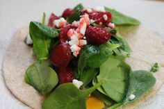tortilla, medium cheddar cheese, grilled chicken, baby spinach, strawberries, goat cheese and raspberry pecan vinaigrette