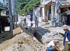 Japan's resurrection after mostly destroyed during WWII starts from infrastructure. This shown here, we see sewage system is renew ed. WWIIで破壊された街の復興はインフラを整えることから始まります。下水工事の様子が見て取れます。