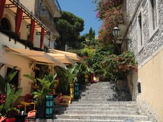 Taormina, Italy - Tiny little winding roads with hairpin turns.  Lots of outdoor cafe's, lots of flavor. We were here in the mid 70's
