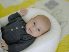 Newborn baby smiling to camera