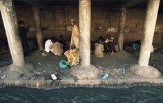 Drug addicts smoke heroin under a bridge along a sewage canal. Quetta, Pakistan (We make all these movies about Zombies. Ever been up close and personal to a long time user? The zombie apocalypse has already occurred. Just Say No, War On Drugs, Take The First Step, Photo Essay, Zombie Apocalypse, Photojournalism, Zombies, Pakistan, Countries