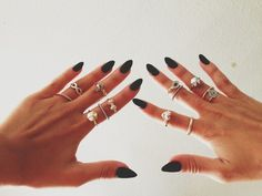 Back stiletto nails, and rings