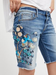 Brandi Denim Shorts | In a low-rise these long jean shorts feature a beautiful and colorful embroidery detailing.    * Raw hem   * Slightly stretchy denim   * Five-pocket style   * Button closure and zip fly