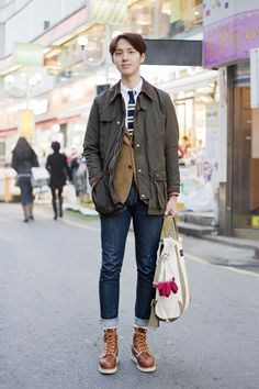 One of Korean boy fashion trend is to wear super slim-fit denim.  Warm hearted boy (Hun-Nam) wearing Corduroy jacket underneath Barbour's waxed coat. Details of accessories and boots! loving his outfit.