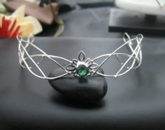 Ive fabricated a Celtic inspired wedding bridal circlet, in sterling silver, featuring 5 Trinity Knots with an 8mm round cabochon of your choosing in the
