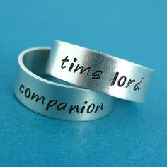 I would make my boyfriend wear the companion one, sorry but I'm the Doctor!Doctor Who Rings Time Lord and Companion -Pair of Adjustable His and Hers Aluminum Rings - your choice of font