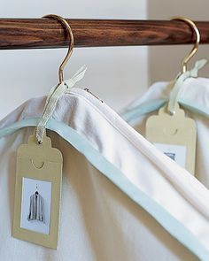When storing out-of-season clothing in garment bags,create a simple tag with the contents to go on the outside.