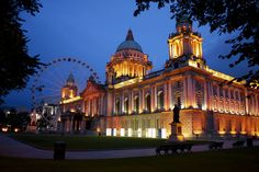 Photo about Belfast City Hall building in the evening. The Belfast Eye can be seen in the background. Image of christmas, bridge, gothic - 11298180 Belfast Northern Ireland, Belfast City, Cheap Flights, City Break, Christmas Images, British History, Fantasy World, Where To Go, Empire State Building