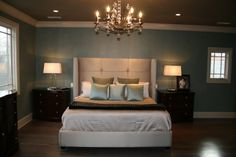 Master BR- dark hardwoods, blue walls, glass lamps