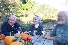 The Edwards and Vincent Arroya share a laugh and a glass in Napa