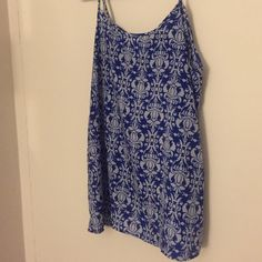 Royal blue tank top with bow accent on back Royal blue and white and light blue pattern, spaghetti straps, adorable bow on the back as shown. Perfect for a night out. Purchased from Francesca's Boutique Blue Rain Tops Tank Tops