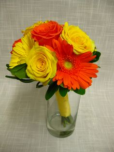 Bridesmaids bouquet of yellow and orange roses and gerbera daisies.