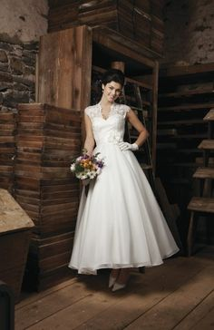 Vintage feel.  Kinda like the flower detail.  Flower and belt great ways to introduce color.   Sincerity Bridal Wedding Dresses Photos on WeddingWire