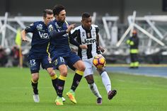 "Juventus' defender from Brazil Alex Sandro (R) fights for the ball with Chievo's midfielder from Argentina Mariano Izco (L) and Chievo's midfielder from Argentina Lucas Castro during the Italian Serie A football match Chievo Verona vs Juventus at ""Bentegodi Stadium"" in Verona on November 6, 2016.  / AFP / GIUSEPPE CACACE"