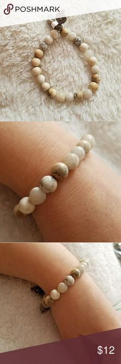 """Bracelet white gemstone boho gypsy stretchy beaded Beautiful,natural, great, quality gemstones beaded on thick elastic band.  Decorated with silver plated vintage style Bali beads.  6.5"""" stretchy  White jasper the Queens Hand by Naya Jewelry Bracelets"""