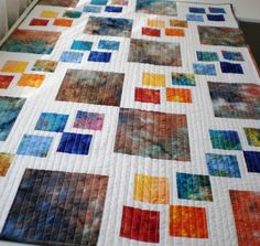 Patchwork baby or lap quilt rainbow of hand dyed by StephsQuilts