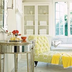 House Beautiful - bathrooms - mirrored vanity, mirrored bathroom vanity, kidney shaped vanity, vanity mirror, chaise lounge, bathroom chaise lounge, glass front linen cabinet, french windows, tufted chaise lounge, chaise lounge with caster legs, chaise lounge on caster legs,