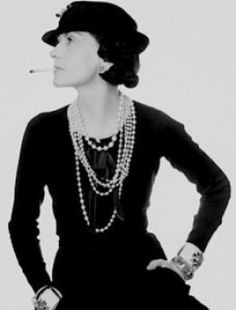 Co Co Chanel wearing her famous faux jewelry