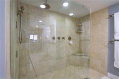 Walk in shower with body sprays, rainhead and bench