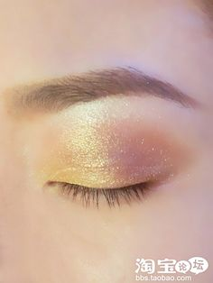 1. Apply primer then use a white pearly shadow to brighten up your eyes  2. Then line the inner portion of your eyes till the half of your lid with sandy gold pigment Line the outer half with a golden brown shadow