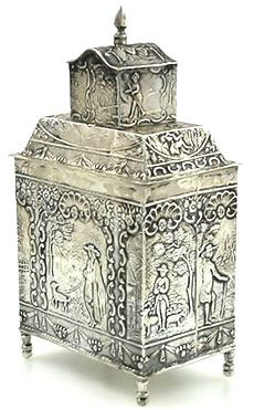 """Dutch figural antique silver tea caddy - A Dutch silver tea caddy measuring 5"""" tall with a weight of 3.75 troy ounces. Ornate repousse detail and a pull cap. The caddy is raised up on four feet."""