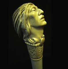 """This is a wonderful carved ivory walking stick featuring a Native American man with his headdress on and wearing a wampum turtle necklace. Such great detail. This stick has a silver Art Nouveau collar, a hardwood shaft and a brass ferrule. This stick measures 33""""x2 1/2""""x1 1/2""""."""