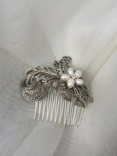 Vintage feather bridal hair comb wedding by CamillaCarrington