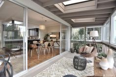 Sliding Glass Door Across The Wall With Skylights And Enclosed Deck