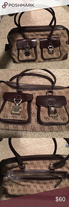Dooney and Bourke purse Brown/tan Dooney and Bourke purse. Gently used. Send me an offer! Need to clear out my closet! Dooney & Bourke Bags Totes