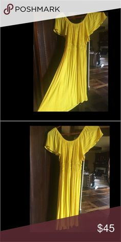 Beautiful bright yellow dress by Hourglass Lilly! This dress is so pretty. It can be worn on the shoulder or off the shoulder. Purchased from a fancy boutique for a tv story I was interviewed in back in 2011. It's very stunning on. I cannot find the size but I would say it's probably a medium. I have worn it when I was smaller and and also when I was medium. It's stretchy so it would probably even fit large. Hourglass Lilly Dresses Midi