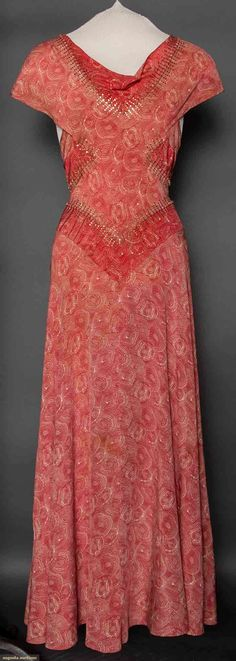 POPPY PRINT EVENING DRESS, 1930s Bias cut, cowl neckline, cap sleeve, V shaped bodice & midriff panels of darker red outlined w/ tiny buttons & gold metallic trim