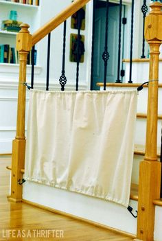 Sew a drop cloth onto two cords for a soft but mostly baby-or dog-blocking stair gate. 35 Brilliant Ways Bungee Cords Can Solve All Your Problems Diy Dog Gate, Diy Baby Gate, Pet Gate, Dog Gates, Gates For Dogs, Baby Gate For Stairs, Stair Gate, House Stairs, Fabric Baby Gates
