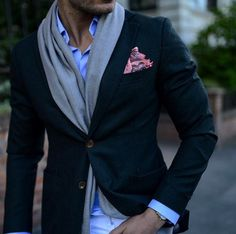 Interesting way of wearing a scarf. Navy Blazer and @serafinesilk pocketsquare.