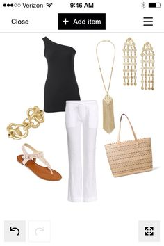 white pants, navy top and gold accessories