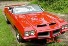 72 GTO Convertible muscle car in red with creme interior. Pontiac Lemans, Pontiac Cars, Pontiac Firebird, Chevrolet Camaro, Best Muscle Cars, American Muscle Cars, Convertible, Us Cars, Cool Cars