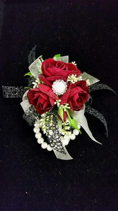 Red spray roses with pearl accents