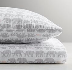 RH baby&child's Elephant Print Crib Fitted Sheet:Beloved for its light weight and superior softness, our cotton muslin fitted sheet and pillowcase are also naturally breathable. Each piece is washed for cozy comfort, and then printed with parading elephants linked big to small and trunk to tail.
