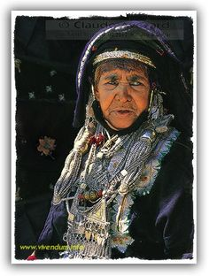 An ancient Omani Badawi lady – wears traditional tribal makeup in her hair and the mass of jewellery that constitutes her family's wealth. When she dies, this will all be melted down and recommissioned as new items – to be used as dowries for her daughters or granddaughters. Thus it's hard to find Omani jewels older than 70 years. It is mostly made out of the Thalers, minted by Marie Theresa of Austria in 1764. © Claude Avézard / Khamis al Mohairbi  stockphotomall.com