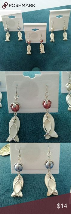 """Handmade dangle earrings fish/starfish silver Brand New!! Handmade dangle earrings. Silver fish over laying a mother of pearl fish, beautiful bead with starfish on top. Multiple colors available...blue, pink, or cream. Only $14 each!!  Measurements: 2"""" long 1/4"""" wide. Jewelry Earrings"""