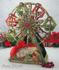 Wow, who doesn't love a great Christmas Ferris Wheel which you can find in SUMMER STREET CARNIVAL SVG KIT.  Chantel used great colors and added the most adorable Reindeer from CHRISTMAS MORNING SVG COLLECTION, the middle is the Ornament from CHRISTMAS ORNAMENTS SVG KIT, and CLARA'S CHRISTMAS STRIPS COLLECTION helps with the embellishing to finish off the wheel!    This file is so versatile, any theme, you choose!