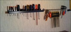 20 Ways to Use IKEA's RIBBA Picture Ledges All Over the House In the garage as a tool rack to hold screwdrivers (next to it is a BYGEL rail) as seen on IKEA Hackers.
