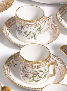 A set of twenty-five Royal Copenhagen 'Flora Danica' coffee cans and twenty-six saucers<br>modern