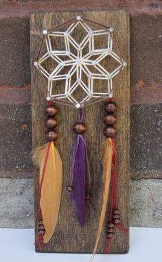 This Mini Dreamcatcher string art is a wonderful addition to rustic decor. It would also make a great gift for family and friends! This
