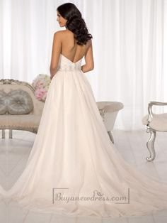 You\'ll love how this Satin and Tulle wedding dress will camouflage your hips and accentuate the small of your waist. It features a sweetheart neckline, figure flattering crisscross ruching on the bodice, and Diamante beading at the natural waist.